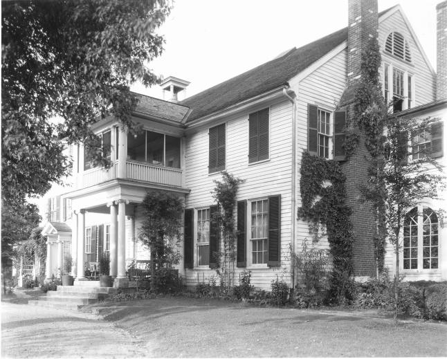 View of house ca 1927. The climbing rose Aviateur can be seen climbing up the house between the parlor windows.