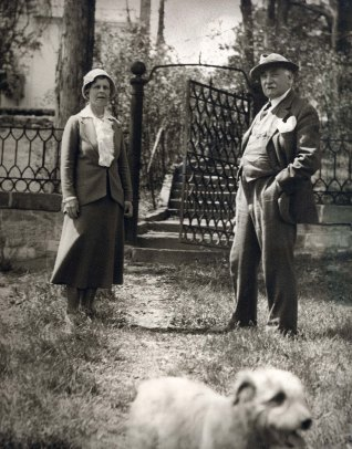 Gari and Corinne Melchers with dog in front of Belmont's lower gate, ca. 1920s.